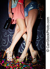 Girls in night club - Legs of girls in high heeled shoes...