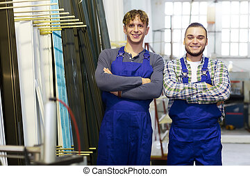 Two workers in coveralls