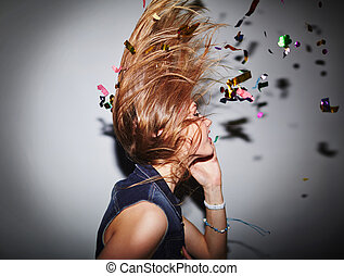 Dancer and confetti - Energetic female dancer with confetti...