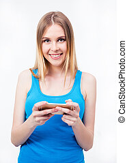 Smiling casual woman using smartphone - Smiling young casual...