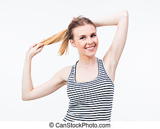 Young happy woman holding her hair