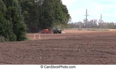 tractor fertilize soil