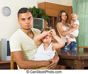 Couple with children having quarrel