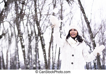 Pretty woman throwing snowball - Pretty woman throwing a...