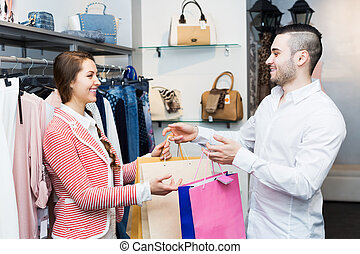 Store clerk serving purchaser - You
