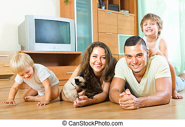 parents and children laughing on the floor