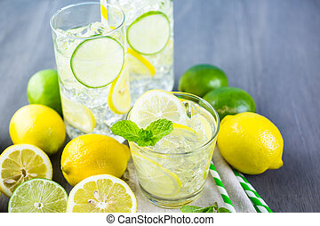 Infused water with fresh citrus fruits and ice.