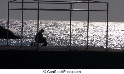 lonely fisherman silhouette, Greece