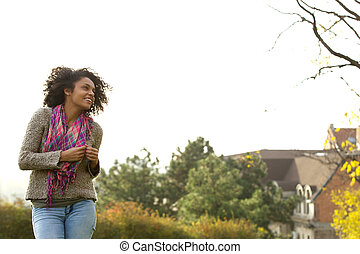 Cute african american young woman smiling - Portrait of a...
