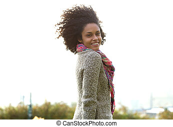 Attractive young mixed race woman smiling