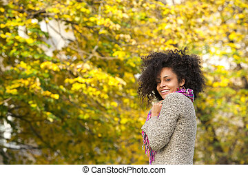 Cheerful young mixed race woman smiling outdoors