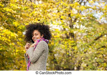 Cute mixed race woman smiling outdoors in nature