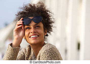 Happy smiling young woman outside