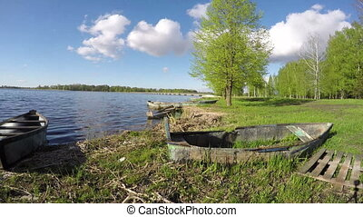 spring lake landscape with boats
