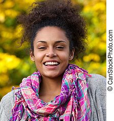 Happy african american woman laughing outside - Close up...