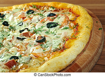 Pizza Regina with tomato, mozzarella, mushrooms, ham,...