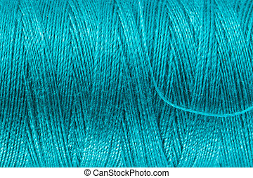 Petrol Blue Sewing Yarn - Background texture and macro view...