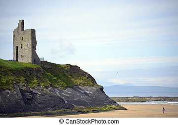 ballybunion castle on the cliffs of a beautiful beach
