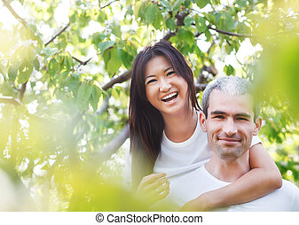 Beautiful couple at the park looking very happy - Beautiful...