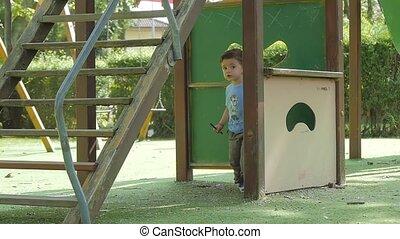 child having fun in playground - little boy in playground in...