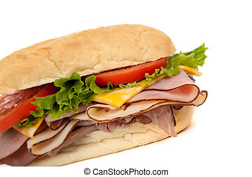 Assorted meat sandwich with fixings on a hoagie - Sandwich...