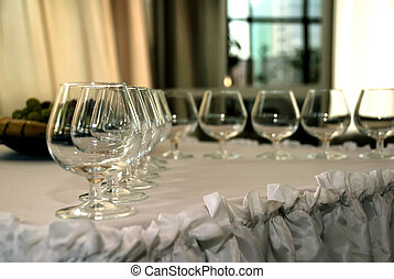 Wineglass against blurry background Grouping of glasses