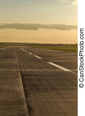 Airstrip at the airport - Empty runway with road markings at...