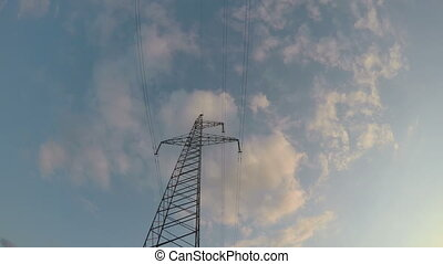 electricity high voltage tower construction and clouds...
