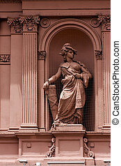 pink marble statue of a women in the monument casa rosada...