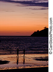 two men in the sunset and the mountain - sunset near a...