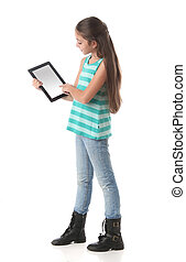 Beautiful pre-teen girl using a tablet computer. Clipping...