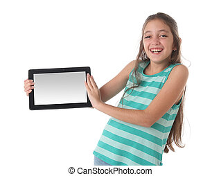 Beautiful pre-teen girl laughing with a tablet computer....