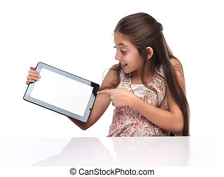 Beautiful pre-teen girl showing a tablet computer. Clipping...