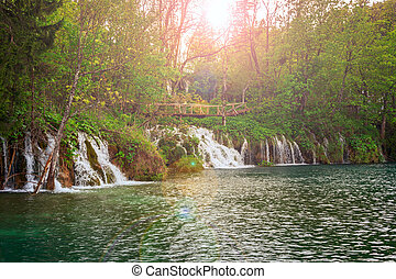Waterfall in deep forest - waterfall in deep forest in...