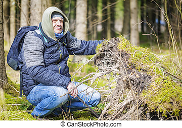 Hiker at the fallen tree roots