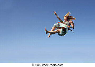 Woman Falling Through the Sky - A young woman is falling as...