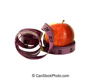 watching my waist - apple and measuring tape on a white...