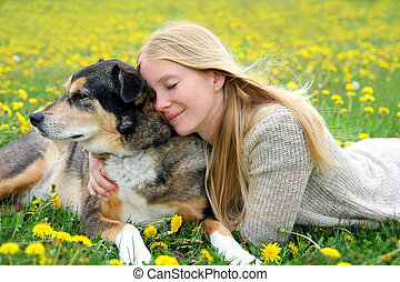 Woman Tenderly Hugging German Shepherd Dog - A girl is...