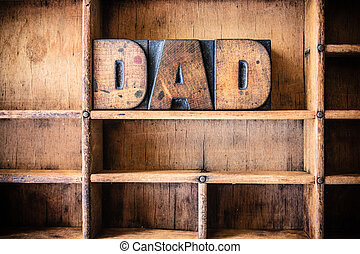 Dad Concept Wooden Letterpress Theme - The word DAD written...
