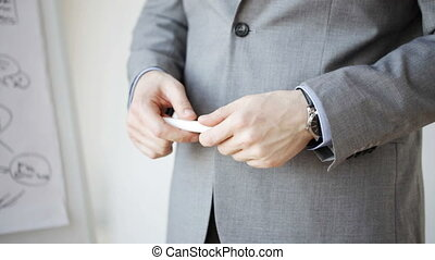 close up of male hands with marker gesticulating - business,...