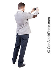 back view of business man on phone photographs.