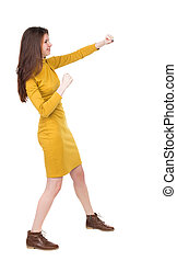 skinny woman funny fights waving his arms and legs Rear view...