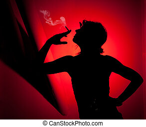 silhouette of woman smoking Profile of woman pulling smoke...