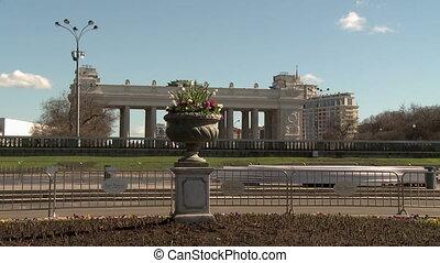 Flowerbed in park on backdrop of citys landmark - Flowerbed...