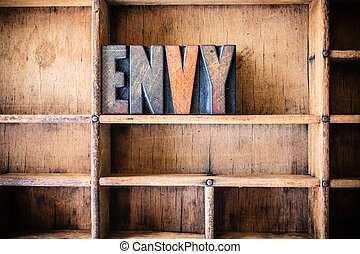 Envy Concept Wooden Letterpress Theme - The word ENVY...