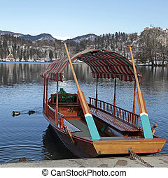 traditional Slovenian boat, on Lake Bled, Slovenia Square...