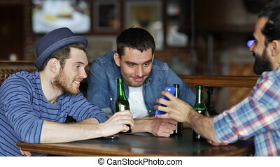 male friends with smartphones drinking beer at bar - people,...