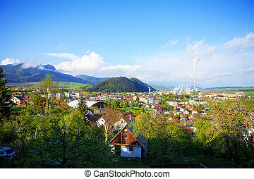 industrial refinery plant in a natural environment and mountain a town, View of a factory in the landscape