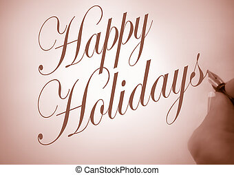 Happy Holidays - Person writing Happy Holidays in...