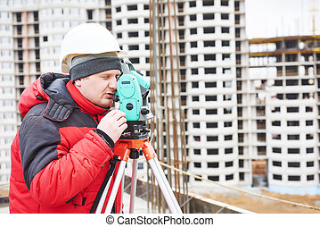 surveyor at construction site - surveyor working with...